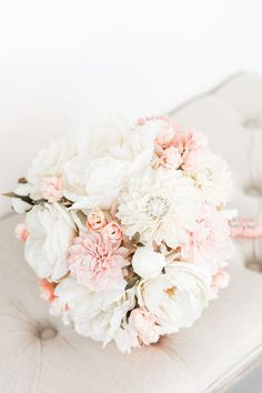 We are completely in love with this cream, blush and antique rose colored bouquet! Our romantic wedding bouquet has a soft color palette and a little bit of bling. With a combination of silk and woode