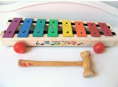 Fisher Price wooden xylophone. I honestly remember playing with this in our church nursery. Seemed like the older the toy got, the harder you had to bang to get a note!