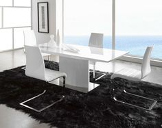 Dining Room. Innovative Futuristic Dining Room Design Ideas. Cozy Minimalist Futuristic Dining Room Design in Neutral Black and White Color Theme with Modern Gloss White Rectangle Dining Table and White Leather Upholstery Cushion Stainless Steel L-Shaped Frames Dining Chair also Soft Black Dining Area Fur Rug