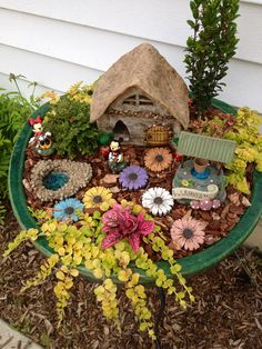 Fairy garden. We will probably place Tinker Bell in it, instead of Mickey and Minnie.