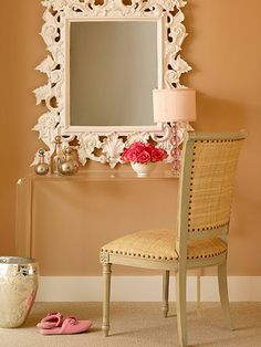 I love the lucite desk paired with the chunky mirror and the light airy color pallet.