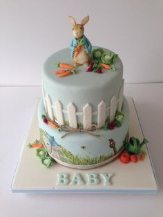 A Beatrix Potter Peter Rabbit cake made by The Rosebud Cake Company for a baby shower but perfect for a birthday party too. CBeebies loves the mini vegetables!