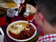 Slow-Cooked Beef in Red Sauce : Guy cooks up some smoky, spicy beef shanks in red sauce at Sabroso.