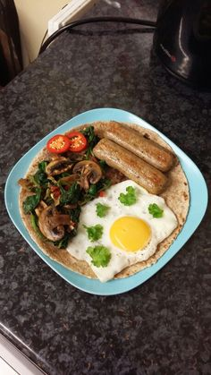 A nice light dinner today ❤ Wholemeal flatbread (shop bought) served with an egg (topped with some fragrant fresh curly parsley) + 2 veggie sausages from @quorn_uk cooked in 1/4 tsp of Biona's coconut oil with sautéed mushrooms + spinach cooked with tamarind sauce. Recipe for the Sautéed Mushrooms + Spinach: In a pan of 1/4 tsp of olive oil, I added 2 chopped garlic cloves and let it cook until brown. Followed with red chilli, fresh curly parsley, chilli flakes and the mushrooms. Add a…