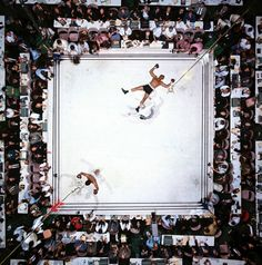 """Ali - Williams (Overhead)"" by Neil Leifer - aerial of Muhammad Ali victorious after his round two knockdown of Cleveland Williams during the 1966 World Heavyweight Title fight at the Astrodome, Houston, Texas, 14 November 1966 (Image # 1002 ) Magnum Photos, Houston Tx, Boxe Mma, Neil Leifer, Der Boxer, Sport Boxing, Capoeira, Photomontage, Rolodex"