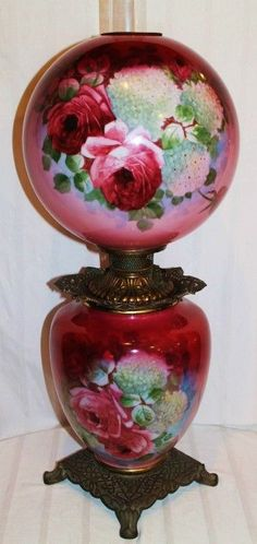 Antique Gone with the Wind Oil Lamp with Roses JAN OMG MAYBE YOUR AUNT EDDIE'S LAMP WAS OLDER THAN WE THOUGHT!!  LOOK AT THOSE FITTINGS!