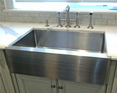 stainless steel farm sink - love the fact that it doesn't chip or stain!  And its BIG!