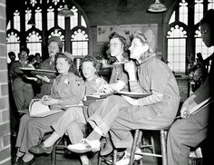 History in Photos: Learning a Trade. Girls at Brighton High School in 1943 Boston are learning how to be car mechanics. From the Leslie Jones Collection.