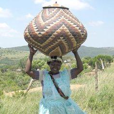 Africa | Proudly holding up her Zulu Wedding basket. | Image © ZanzibarTrading