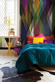 I don't think I'd ever do something like this, but the headboard and colors are so beautiful and inspiring!