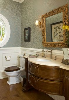 Beautiful traditional powder room.. So happy to see wallpaper in this space. It really dresses it up and gives the space an elegant feel..
