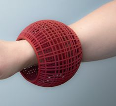 Cage Bangle by Maria Eife. In a fascinating combination of art and technology, the artist creates this sizable yet lightweight bangle using 3-D printing. Interior diameter is 2.6'' wide.