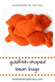 Our bright orange goldfish-shaped bean bags make playtime even more fun: https://www.etsy.com/handiworkingirls/listing/106832531/bright-orange-goldfish-shaped-bean-bags