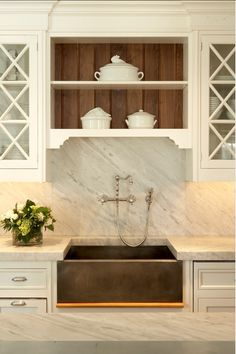 wood & white cabinets, marble & kitchen sink