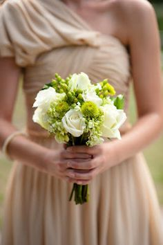 Small bouquet with white roses, green hydrangea, green berries and mums/poms of some sort- perhaps for Bridesmaids bouquets?