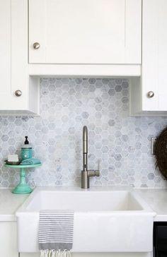 Farmhouse sink, Moen Align Faucet, Carra marble backsplash. Beautiful white IKEA SEKTION GRIMSLOV kitchen with aqua and green accents, a gorgeous marble hexagon backsplash, and quartz countertops. | JustAGirlAndHerBlog.com