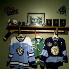 Kids sports shelf. Can hang hockey jerseys, medals and display trophies. All hand crafted.