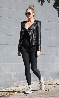 Pregnant Chrissy Teigen in leggings,  a leather motorcycle jacket and aviators