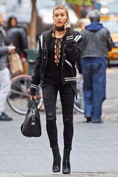 Hailey Baldwin wearing  Saint Laurent Teddy Jacket, The Reformation Avalon Bodysuit, Balmain Verne Mixed-Media Point-Toe Cage Booties, Givenchy Medium Antigona Satchel Bag