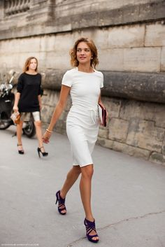 Natalia Vodianova - white dress, plum heels. Love the dress but the shoes.....who is picking the shoes? I need their job!