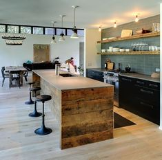 I like the combination of reclaimed wood and the dark cabinets.  ALthough this wood is a bit rougher than I'd want for a kitchen.