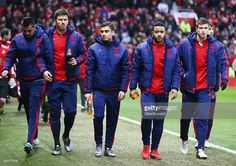Manchester United substitute players walk to the bench prior to the Barclays Premier League match between Manchester United and Swansea City at Old Trafford on January 2, 2016 in Manchester, England.