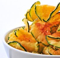 Zucchini chips - zucchini, sea salt, pepper and olive oil.  Bake for 20-30 minutes until golden brown