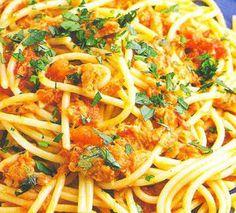 Spaghetti with tuna and anchovy.Italian spaghetti with tomato puree,tuna and anchovy