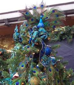 Peacock themed Christmas tree. Can't wait for the day after Thanksgiving!
