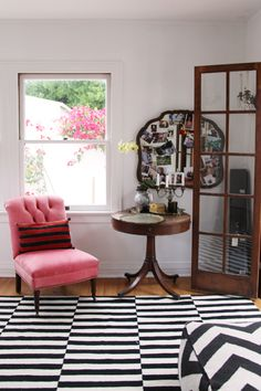 pink tufted slipper chair with black and white ikea rug = love (Style at Home with Heidi Merrick -photographed by Jessie Webster)
