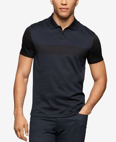 The colorblocked design on this Calvin Klein jersey polo gives it a contemporary look that blends perfectly with the modern slim fit. | Cotton | Machine washable | Imported | Slim fit | Three-button c