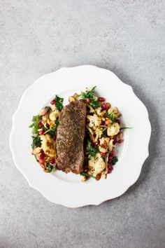 Romantic Steak Dinner for two: Tender, herb crusted sirloin with a sautéed pomegranate kale salad. Gluten Free, Paleo, Whole 30, Dairy Free, and Clean Eating approved.