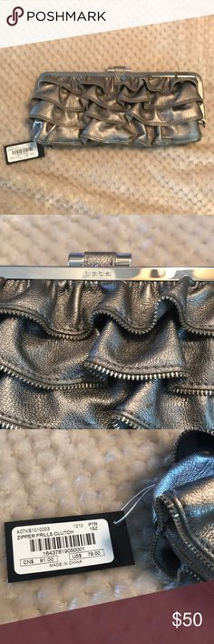 Zipper Frills Clutch purse. Brand new Brand new with tags. Metallic silver with zipper edges. bebe Bags Clutches & Wristlets