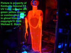 Seven foot tall giant halloween hanging pumpkin ghost, it's black light reactive, orange and very very angry looking. This would make a nice front door decoration for Halloween.