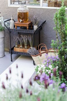 This outdoor table setting is full of lavender and this beautiful post has so many lavender tips and ideas. Lavender is perfect for a summer table.