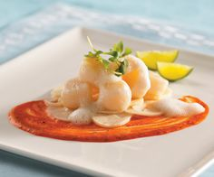 NANTUCKET BAY SCALLOP CRUDO WITH SHAVED HEART OF PALM, KEY LIME, COCONUT EMULSION AND HARISSA