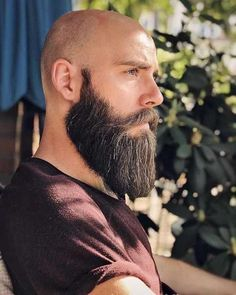 Looking to combine bald with beard styles? The good news is that you aren't alone! More and more men are trying one style or another. This gives you a lot of bald with beard styles to choose from. Faded Beard Styles, Long Beard Styles, Beard Styles For Men, Hair And Beard Styles, Viking Beard Styles, Bald Men With Beards, Bald With Beard, Beard Fade, Full Beard