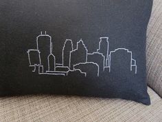 A simple how to for embroidered city skyline pillows.