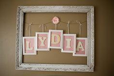 Inexpensive nursery wall art: garage sale frame spray painted, wire and framed letters - #nursery #DIY #wallart