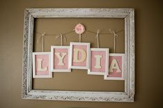 Inexpensive nursery wall art: garage sale frame spray painted, wire and framed letters - #nursery #DIY #wallart