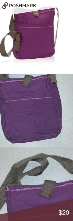 NWT Thirty-One Retro Metro Crossbody Plum This fun bag has been discontinued and is now available for you! It is a 100% cotton canvas style bag with distressed edges. The purple is a deeper plum color. Strap drop is 32 inches which is adjustable if tied as seen in photos. Snap closure over the top. Large outer pocket. Interior boasts two slide pockets and one larger zipper pocket. Bag is new in bag and was still in the bright pink 31 customer bag. I forgot I ordered it at least a…