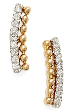 Designed to comfortably rest along the earlobe, these sparkling ear crawlers are punctuated with a gracefully curved arc of light-catching diamonds.