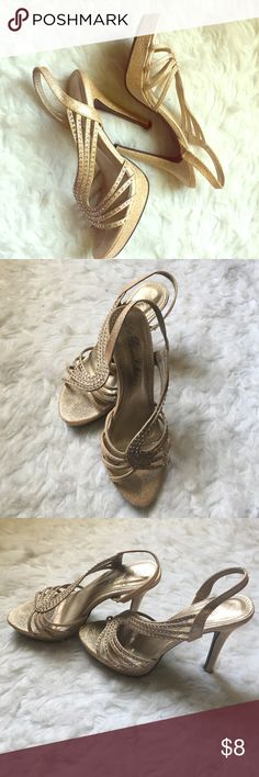 Gold, sparkly heels. Elegant look. Wore for prom back in high school never worn again. Super comfortable! Would look great with a super classy, sexy dress. De Blossom Collection Shoes Heels