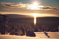 A RAY OF LIGHT. We've seen this amazing halo effect just a couple of days ago from the Pallastunturi Fell in Northern Lapland. The effect happens when the light is reflected in the icy particles in the athmosphere. On that day it was -25 degrees!
