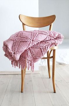 .Vintage pink crocheted blanket