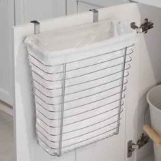 Get an over-the-cabinet-door wastebasket. | 44 Cheap And Easy Ways To Organize Your RV/Camper - campinglivezcampinglivez