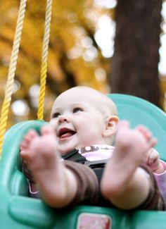 happy baby.  shot with 50mm lens f/1.8.   Focused on her eyes, everything else is blurred.