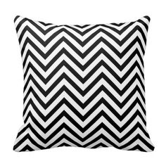 A modern and stylish black and white chevron zigzag pattern throw pillow.