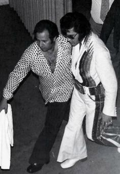Elvis being rushed off stage by road manager,  Joe Esposito, College Park, Maryland. September 28, 1974.