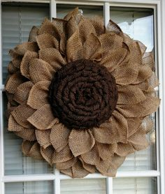 Rustic burlap sunflower by JFPrettyLittleThings on Etsyhow to make a burlap sunflower wreathRemember to have the maximum quality setting selected too. It's incredibly easy that you fill in all your details because the item page has some very simple t Burlap Projects, Burlap Crafts, Wreath Crafts, Diy Wreath, Wreath Burlap, Sunflower Burlap Wreaths, Burlap Flowers, Fabric Flowers, Sunflower Crafts